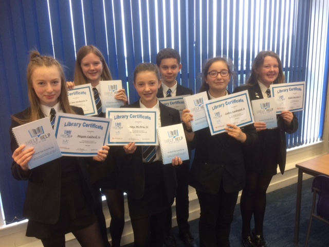 A picture of pupils with certificates